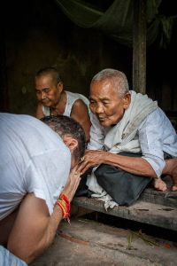 A Buddhist nun blesses tour guide Nathan Horton in a village outside Siem Reap, Cambodia.