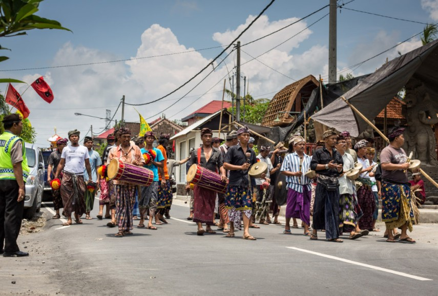 Drummers do their best to confuse the spirit during the Bali funeral procession. Picture: Chris Mannolini