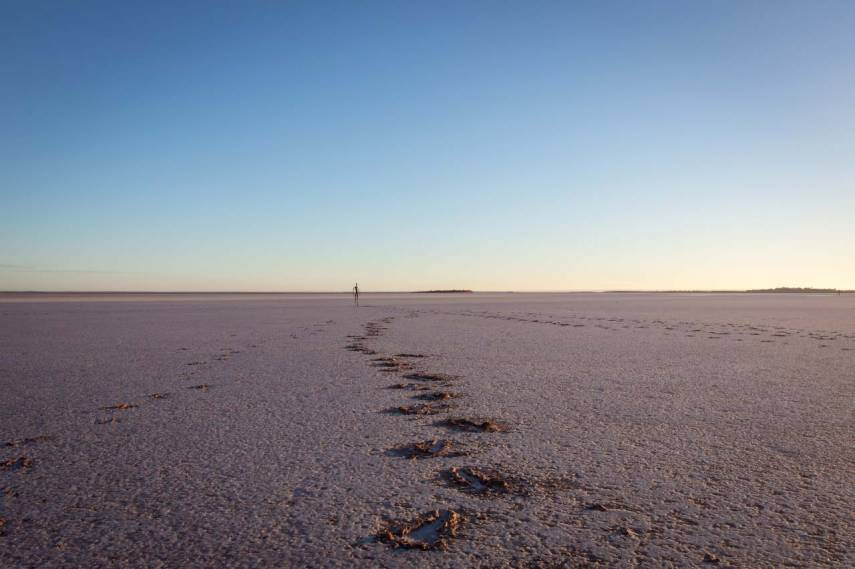 Footprints lead to one of the Antony Gormley sculptures at Lake Ballard, Western Australia. Picture: CHRIS MANNOLINI