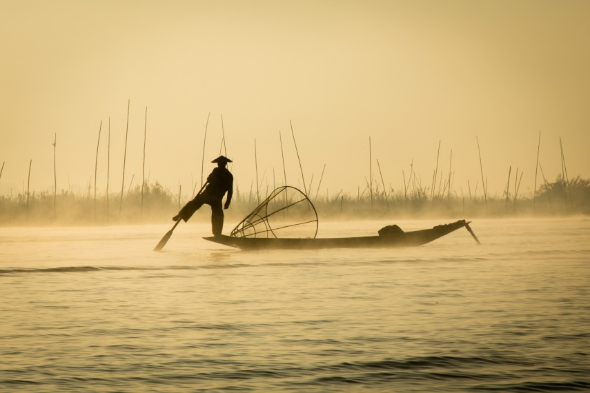 "A ""one-legged"" fisherman in the early morning mist of Inle Lake. Picture: CHRIS MANNOLINI"