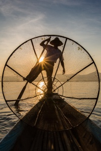 Towards the end of a most enjoyable day on Inle Lake, and a silhouette shot of a fisherman, with sun burst. Picture: CHRIS MANNOLINI
