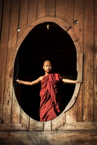 "A novice monk at the Shwe Yaunghwe Kyaung, or ""oval window"" monastery at Nyaungshwe, Myanmar. Picture: CHRIS MANNOLINI"