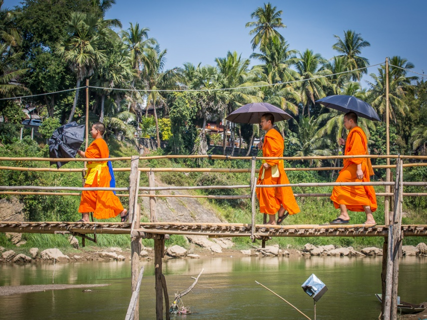 Three monks cross the Nam Khan in Luang Prabang, Laos. Picture: Chris Mannolini