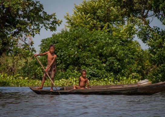 Boys on a boat along the Sangkae river in northwest Cambodia. Picture: Chris Mannolini