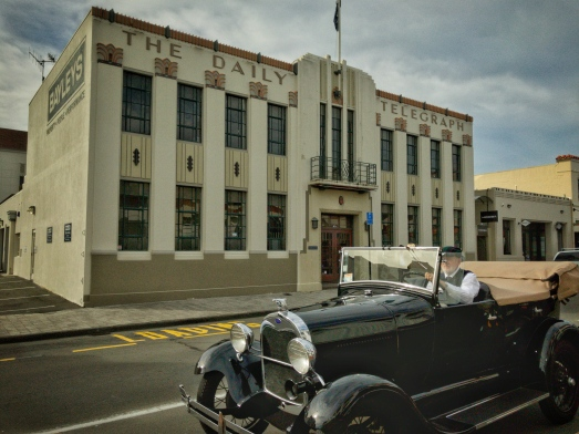 A vintage car drives past the Daily Telegraph building, in Napier, New Zealand. Picture: Chris Mannolini.