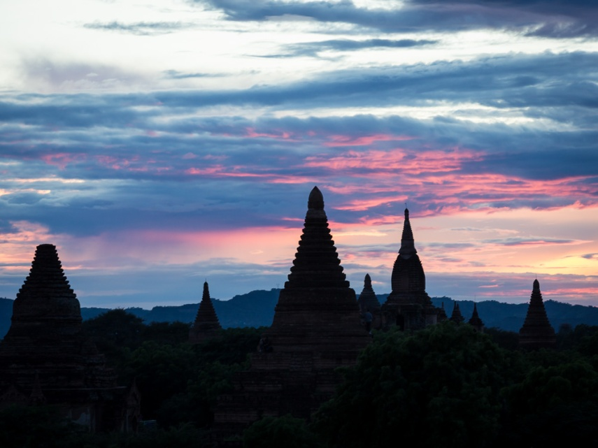 The sun sets behind pagodas in Bagan, Myanmar. Picture: Chris Mannolini